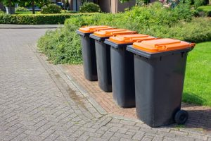 Row,Of,European,Grey,Waste,Bins,Along,Street